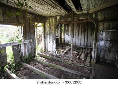 Abandoned farm home deteriorating from exposure to weather and the elements