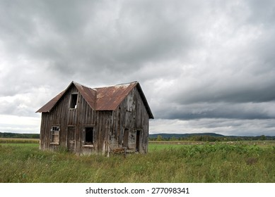 Abandoned Farm House with Stormy Sky