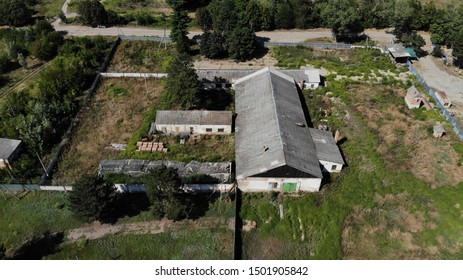 Abandoned farm in Russia. Abandoned farm in Krasnodar region. Abandoned farm from the air. Aerial view of the abandoned farm.