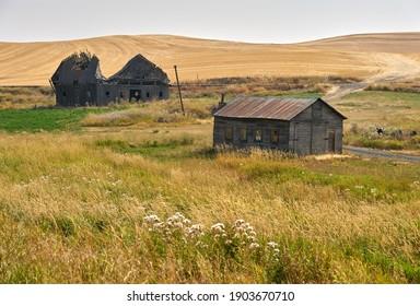 Abandoned Farmhouse and Barn Palouse Washington State. Abandoned buildings dot the landscape in the Palouse area of Washington State, USA.