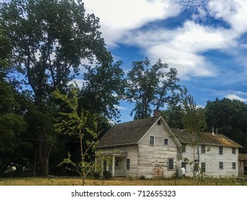 Abandoned Farmhouse In Countryside