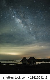 abandoned farmhouse and milky way in dark night