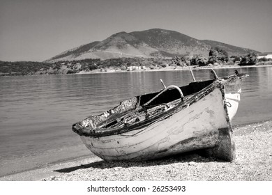 Abandoned fisherman boat on the shore of the Adriatic sea.