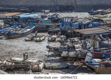 Abandoned fishing boat by the dock in Xiamen, Fujian Province, China