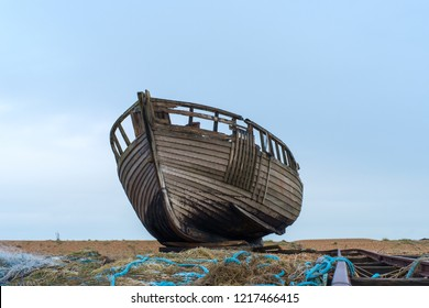 An abandoned fishing boat left to rota and decay on the beach