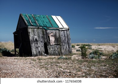 abandoned fishing hut or shed. old wooden cabin on south coast of england in Dungeness