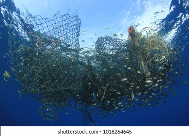 Abandoned fishing net. Ghost net environmental ocean pollution