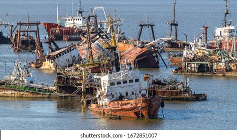 Abandoned fishing vessels in the harbor of Montevideo Uraguay.