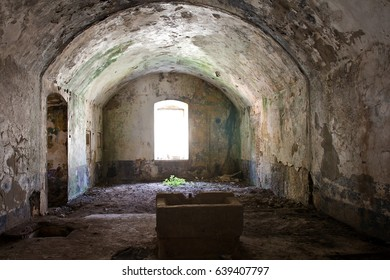 Abandoned fortress Kabala in Montenegro. Old stone empty room with a window and some concrete well