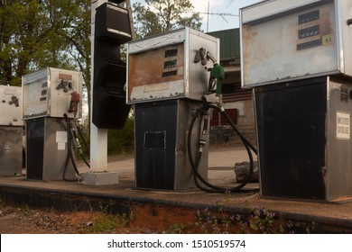 Abandoned Gas Station with Old Fashioned Pumps