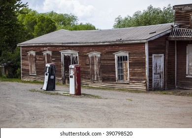 Abandoned gas station with rundown barn