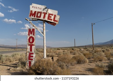 Abandoned generic rustic motel sign is falling apart and decaying in the California desert, near Olancha, CA