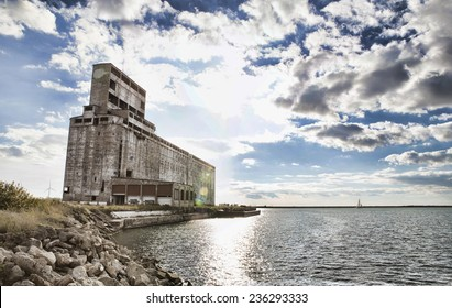Abandoned grain elevator on the shores of Lake Erie outside of Buffalo, New York. Image is filtered high contract / HD style.