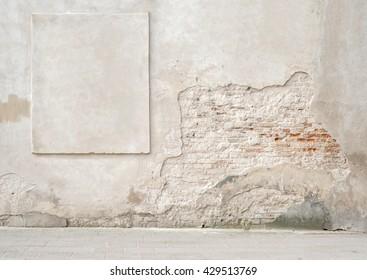 abandoned grunge cracked brick stucco wall with a stucco frame
