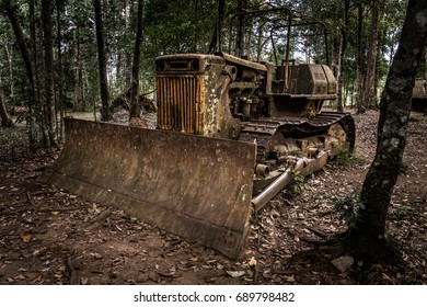 An abandoned grungy broken tractor in woods