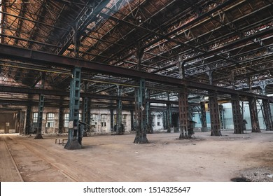 Abandoned hall in a dirty and old factory.