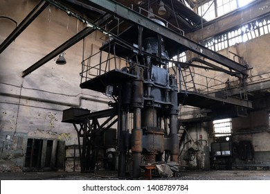 Abandoned hall forge with forging hammer in former shipyard areas. The Imperial Shipyard Trail,  Gdansk Shipyard, Poland