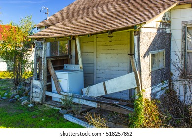 Abandoned Home With Washer On Porch