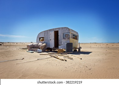 Abandoned Homeless Trailer in Desert Sand