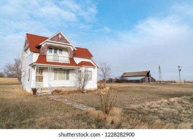 An abandoned homestead and farmhouse, in the plains of northeast Montana.