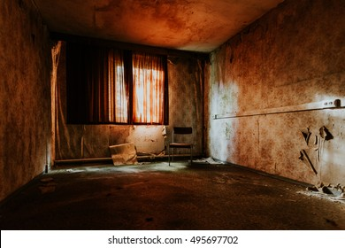Abandoned hotelroom with a chair and red light in Germany