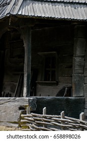 Abandoned house. Abstract background. Medieval farm house. Black wooden house