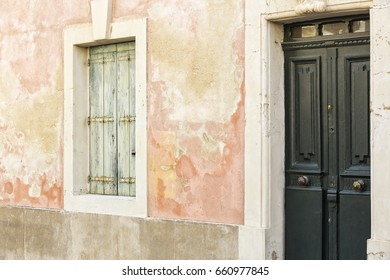 Abandoned house with closed shutter and door