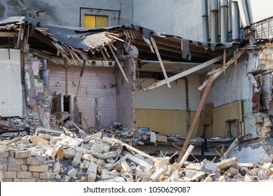 An abandoned house collapses in a poor neighborhood. The house is destroyed. Cracks in wall of house. Destruction of old houses, earthquakes, economic crisis, abandoned houses. Broken unfit house