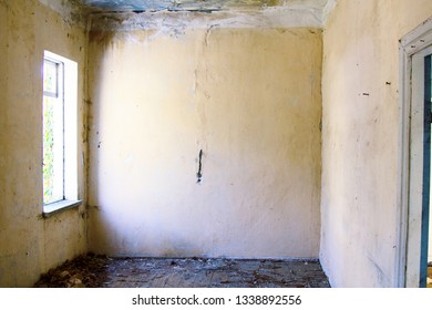 Abandoned house with empty rooms, signs of human desolation