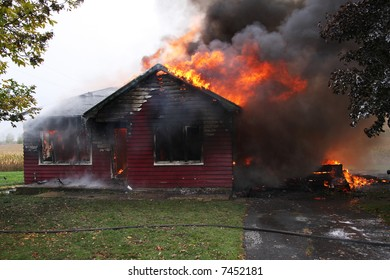 Abandoned house in flame, house is still up but flames are all over