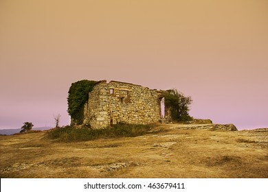 Abandoned house in the hill at sunset (La Mussara, Tarragona, Spain)
