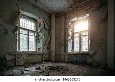 Abandoned house interior, dirty room, rotten peeled walls.