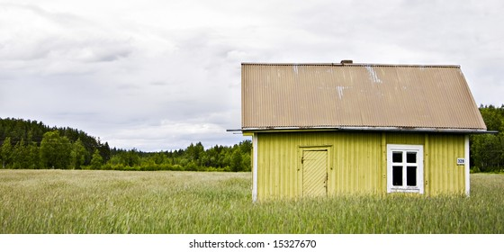 abandoned house in the middle of a field in finland