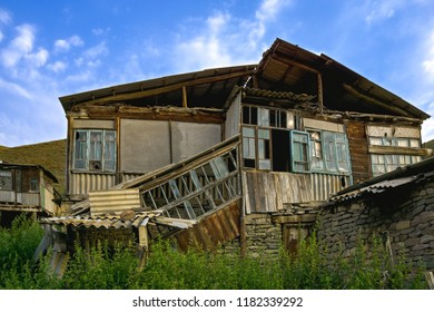 Abandoned house in mountain village. Horizontal shot