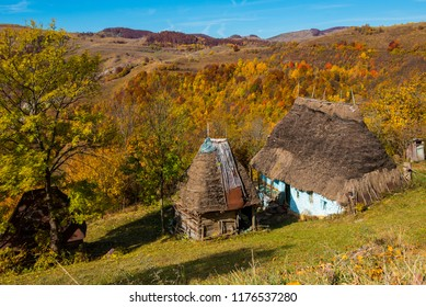 Abandoned house, in the mountains. Colorful autumn forest