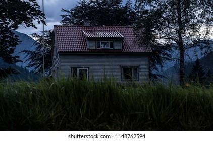 Abandoned house at night