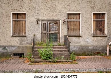 Abandoned house with overgrown stairs in Buckow (Maerkische Schweiz)