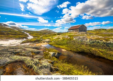 Abandoned house in the wilderness and a fairy-tale landscape by the river. Norway, Geilo between R13 and Eidfjord