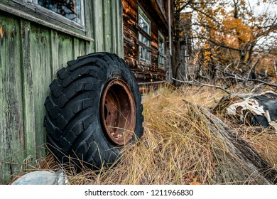 abandoned houses in the chernobyl zone with tracktor wheel