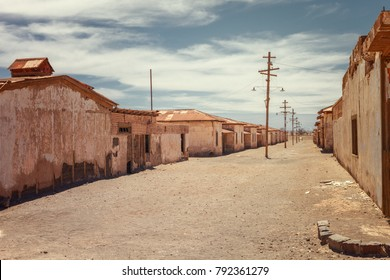 Abandoned houses of a street deserted in the saltpeter Humberstone, old ghost town used to obtain infinite products derived from saltpeter, Atacama desert, northern Chile