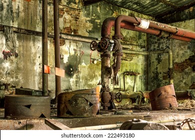 Abandoned Industrial building interior. Old damaged boiler room.