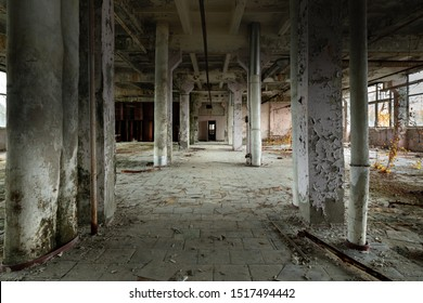 Abandoned industrial interior with large columns