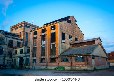 Abandoned industrial plant backyard at sunset, Veneto, Italy