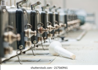 Abandoned industrial textile machines in a row