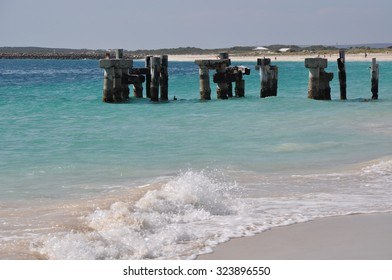 Abandoned jetty remains in the turquoise Indian Ocean waters on the coast of Jurien Bay in Western Australia/Abandoned Jetty in Turquoise Waters/Jurien Bay, Western Australia