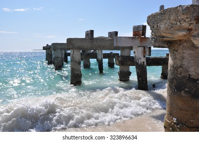 Abandoned Jetty ruins in the glistening Indian Ocean waters with waves rolling in in Jurien Bay, Western Australia/Jurien Bay Abandoned Jetty#6/Western Australia