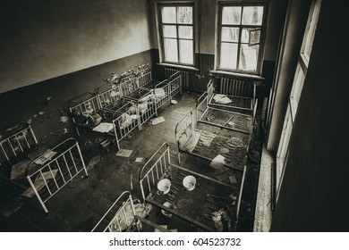 Abandoned kindergarten in Chernobyl exclusion zone. Kopachi village. Ex Soviet interior. Legacy of USSR. Chernobyl exclusion zone. Pripyat. Ukraine. Violence against children. Atmosphere of fear.