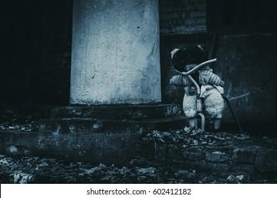 Abandoned kindergarten in Chernobyl exclusive zone. Kopachi village. Lost teddy bear. Autumn in zone. Violence against children. Atmosphere of fear and loneliness. Ukraine.