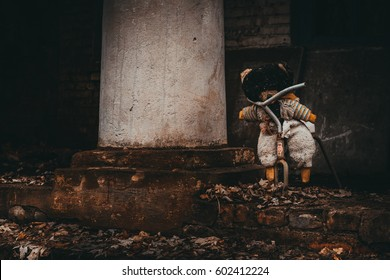 Abandoned kindergarten in Chernobyl exclusive zone. Kopachi village. Lost teddybear. Autumn in zone. Violence against children. Atmosphere of fear and loneliness. Ukraine.