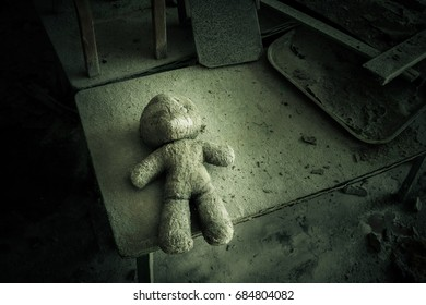 Abandoned kindergarten in Chernobyl exclusive zone. Kopachi village. Lost toys. Violence against children. Sexual abuse  Atmosphere of fear and loneliness. Ukraine.